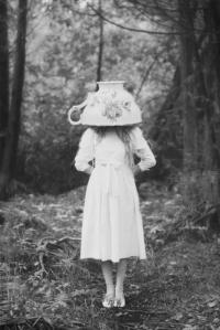 girl with large teacup on head